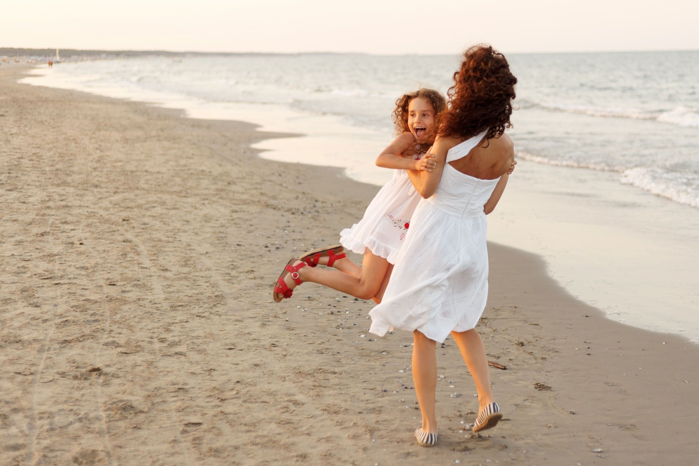 mother-daughter-beach-sunset-min.jpg